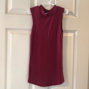 Form fitting; ribbed; knitted; high-neck tank top